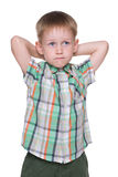 Little boy imagines. A cute little boy imagines on the white background royalty free stock photos