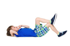 Little boy imagines on the floor. A smiling little boy imagines on the white background stock images