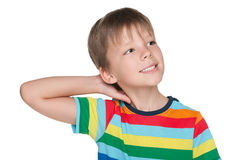 Little boy imagines. A little boy in striped shirt imagines against the white background stock photos