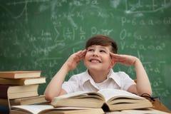 Little boy imagining Stock Photos