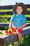Little Boy In Funny Hat With Fruits Stock Photo