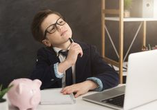 Free Little Boy In Suit Thinking About Finance Royalty Free Stock Photo - 123313165