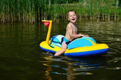 Little boy with inflatable boat Stock Image