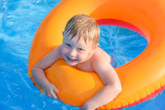 Little boy on an inflatable circle in the water Royalty Free Stock Photo