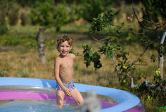 Little boy in the inflatable pool. Royalty Free Stock Photo