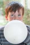 Little boy inflate balloon Royalty Free Stock Photo