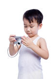 Little boy  interesting digital compact photo camera Stock Photos