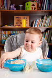 Little boy investigating pasta Stock Photography