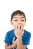 Little boy itchy his mouth on white background Stock Photo