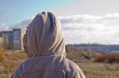Little boy jacket costs a back on nature. The little boy in a jacket costs a back on the nature in the autumn and looks at a city in the distance Royalty Free Stock Image