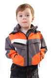 Little boy in jacket and jeans Stock Images