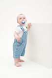 Little boy in jean dungarees Stock Photos