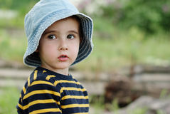 Little boy in jeans hat outdoors Royalty Free Stock Image