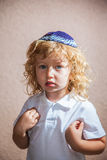 The little boy with in Jewish knitted kippah Stock Photography