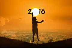 Little boy  jump touch sunset new year 2016 Royalty Free Stock Photos