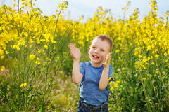Little boy jumping and clapping and having fun among the bright Royalty Free Stock Photos