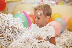 Little boy jumping and having fun celebrating birthday. Stock Photos