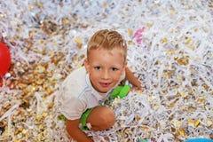 Little boy jumping and having fun celebrating birthday. Royalty Free Stock Photos
