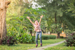 Little boy jumping and running in the park outdoor Royalty Free Stock Photos