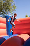 Little boy jumps on a bouncy castle Royalty Free Stock Images