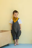 Little boy in a jumpsuit Stock Image