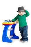 Little boy and the keyboard on white background. funny boy baby. Stock Photo
