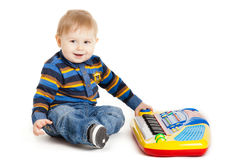 Little boy and the keyboard on white background. funny boy baby. Royalty Free Stock Photography