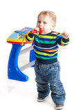 Little boy and the keyboard on white background. Funny boy baby. young DJ Stock Image