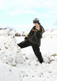 Little boy kicking big snowball Royalty Free Stock Photo
