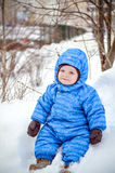 Little boy kid enjoying a day out playing in the winter forest Stock Photography