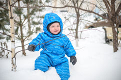 Little boy kid enjoying a day out playing in the winter forest Royalty Free Stock Images