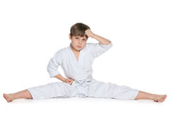 Little boy in kimono on the floor Stock Images