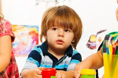 Little boy in kindergarten Stock Images
