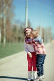 Little boy kiss girl on the street Royalty Free Stock Photo