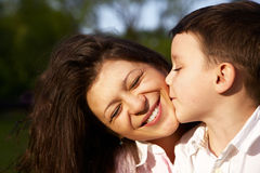 Little boy kiss his mother Royalty Free Stock Images