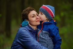 Little boy kiss mother. Photo of little boy kissing mother Royalty Free Stock Images
