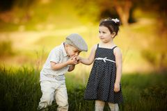 Little boy kissed a girl Stock Photos