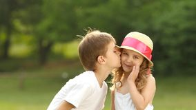 Little Boy Kisses The Girl On The Cheek She Is Embarrassed And