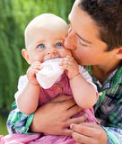 Little boy kissing baby sister Royalty Free Stock Photo