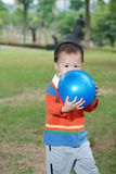 Little boy kissing the balloon Stock Images