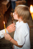 The little boy a kissing cross stock images