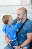Little boy kissing  hugging  dad Royalty Free Stock Photos