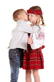 Little boy kissing a little girl Royalty Free Stock Image