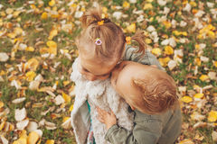 Little boy kissing a little girl Stock Images