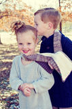 Little boy kissing sister Royalty Free Stock Images