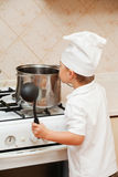 Little boy on kitchen Stock Photography