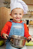 Little boy on kitchen Stock Photos
