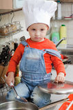 Little boy on kitchen Stock Images
