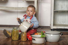 Little boy in the kitchen Stock Photos