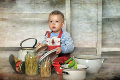 Little boy in the kitchen Stock Photography